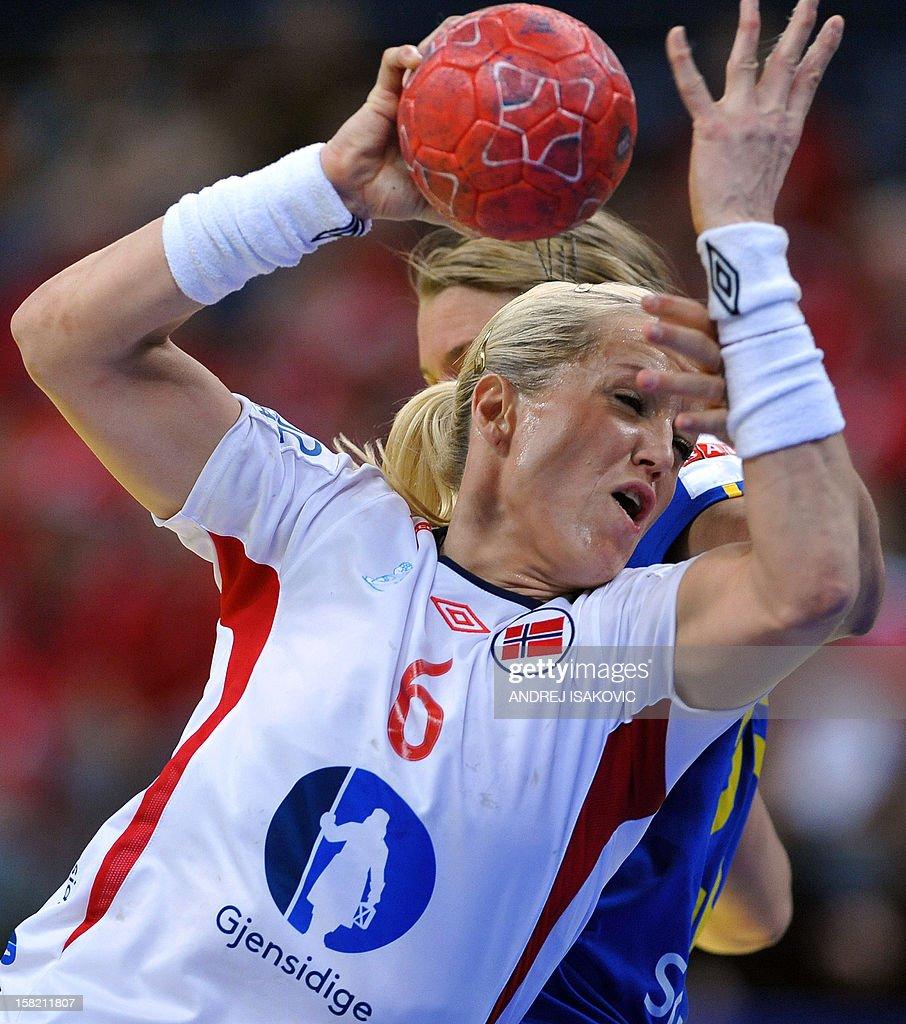 Norway's Heidi Loke vies with Sweden's Isabelle Gullden (hidden) during their Women's EHF Euro 2012 Handball Championship match Norway vs Sweden on December 11, 2012, at the Belgrade Arena.