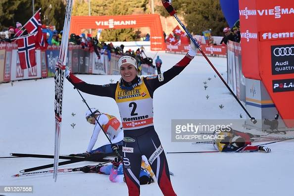 Norway's Heidi Weng celebrates as she crosses the finish line to win the Women's 9 km pursuit free competition of the 'Tour de Ski' Cross Country...
