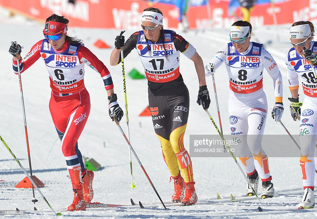 Norway's Heidi Weng (L), Germany's Nicole Fessel (2nd L) and Sweden's Charlotte Kalla (R) compete during the Women's Cross Country 30 km Classic race of the FIS Nordic World Ski Championships on March 2, 2013 at Val Di Fiemme Cross Country stadium in Cavalese, northern Italy.