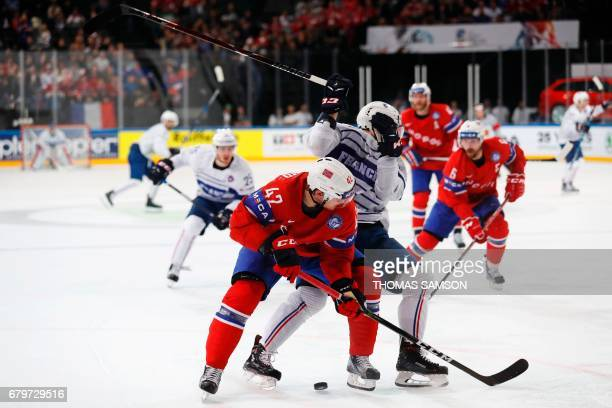 Norway's Henrik Odegaard controls the puck during the IIHF Men's World Championship group B ice hockey match between France and Norway in Paris on...