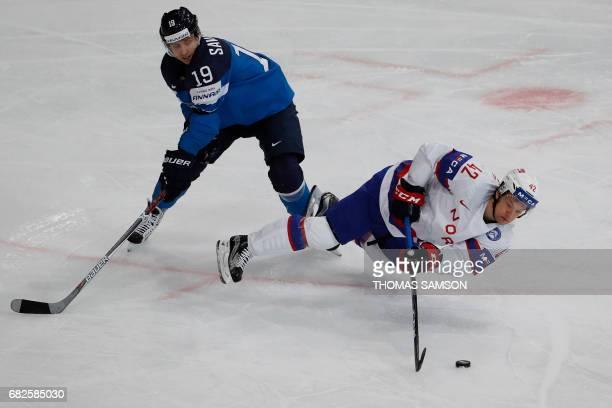 Norway's Henrik Odegaard vies with Finland's VeliMatti Savinainen during the IIHF Men's World Championship group B ice hockey match between Norway...