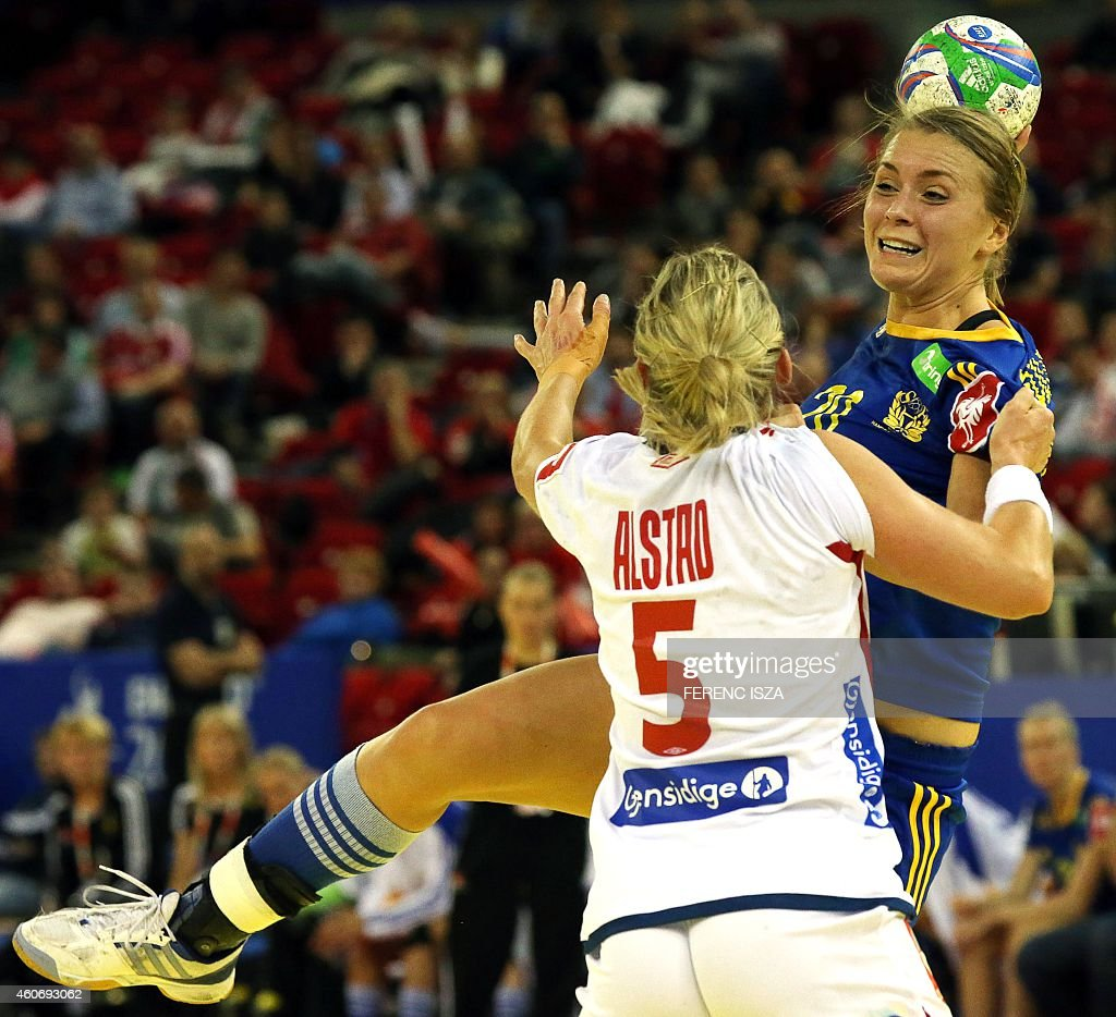 Norway's Ida Alstad fights for the ball with Sweden's Isabelle Gullden in 'Papp Laszlo' hall of Budapest on December 19, 2014 during the semifinal of Women's European Championships.