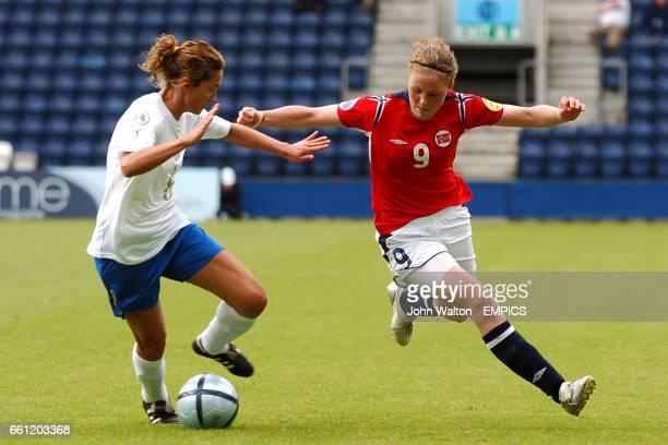 Norway's Isabell Herlovsen and Italy's Damiana Deiana battle for the ball