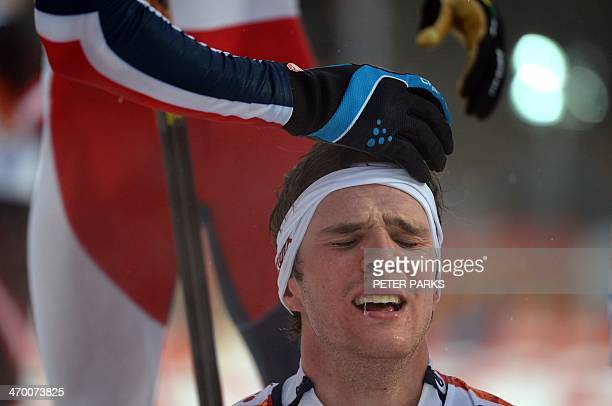 Norway's Joergen Graabak reacts after winning gold in the Nordic Combined Individual LH / 10 km at the RusSki Gorki Jumping Center during the Sochi...