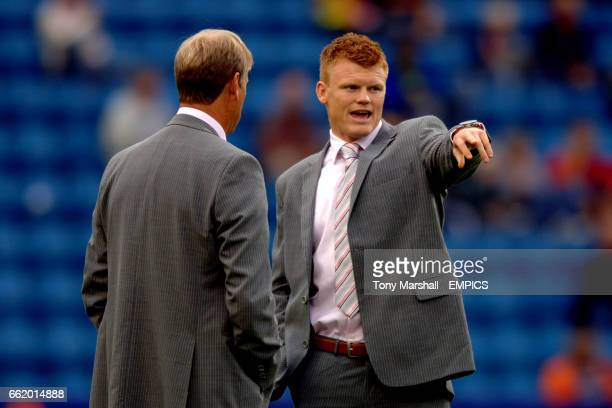 Norway's John Arne Riise chats with coach Age Hareide