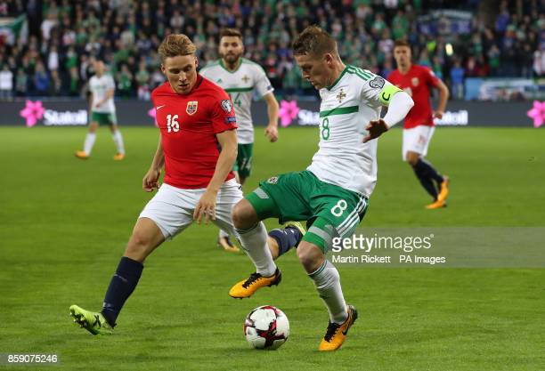 Norway's Jonas Svensson and Northern Ireland's Steven Davis in action during the 2018 FIFA World Cup Qualifying Group C match at the Ullevaal Stadion...