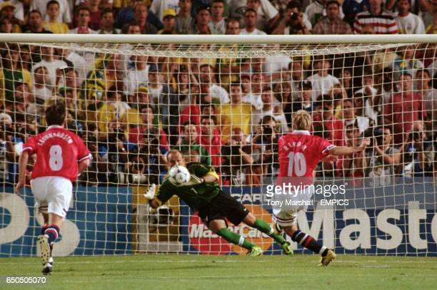 Norway's Kjetil Rekdal scores the winning goal from the penalty spot past Brazil's Taffarel