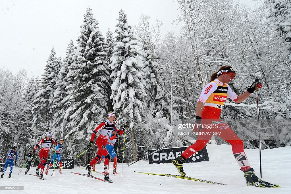 Norway's Kristin Stoermer Steira (C) and Poland's Justyna Kowalczyk (R) compete compete during Ladies' 7,5 km classic + 7,5 km freestyle Skiathlon of FIS Cross Country skiing World Cup at Laura Cross Country and Biathlon Center in Russian Black Sea resort of Sochi on February 2, 2013. Norway's Kristin Stoermer Steira took the first place ahead of Russia's Yulia Tchekaleva and Germany's Nicole Fessel. AFP PHOTO/KIRILL KUDRYAVTSEV