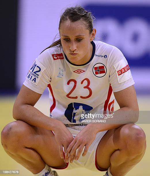 Norway's leftwing Camilla Herrem reacts at the end of the 2012 EHF European Women's Handball Championship final match Norway vs Montenegro on...