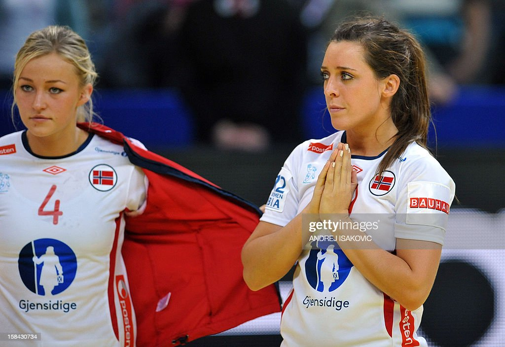 Norway's Linn Gosse (L) and Stine Bredal Oftedal react at the end of the Women's EHF Euro 2012 Handball Championship final match Norway vs Montenegro on December 16, 2012, at the KOMBANK Arena in Belgrade. Montenegro won the gold medal, Norway won the silver, and Hungary won the bronze. AFP PHOTO / ANDREJ ISAKOVIC