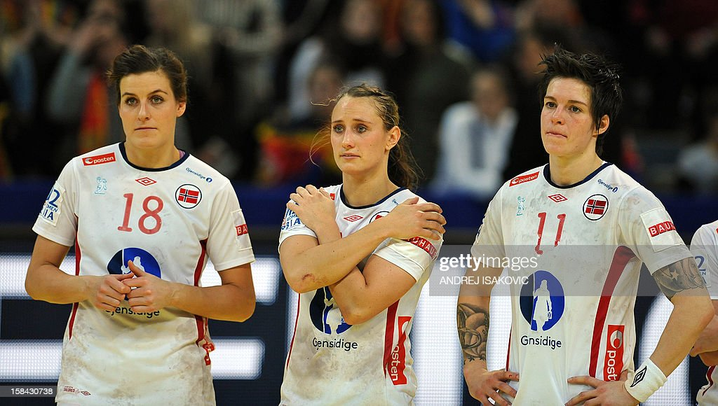 Norway's Linn Gosse (C), Linn-Kristin Riegelhuth Koren (L) and Anja Edineact react at the end of the Women's EHF Euro 2012 Handball Championship final match Norway vs Montenegro on December 16, 2012, at the KOMBANK Arena in Belgrade. Montenegro won the gold medal, Norway won the silver, and Hungary won the bronze.