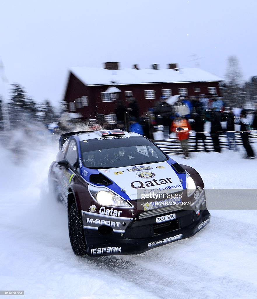 Norway's Mads Ostberg and his co-driver Sweden's Jonas Andersson steer their Ford Fiesta RS WRC during Mitandersfors stage, the 17th of Rally Sweden, second round of the FIA World Rally Championship on February 10, 2013 in Kirkenaer, Norway.
