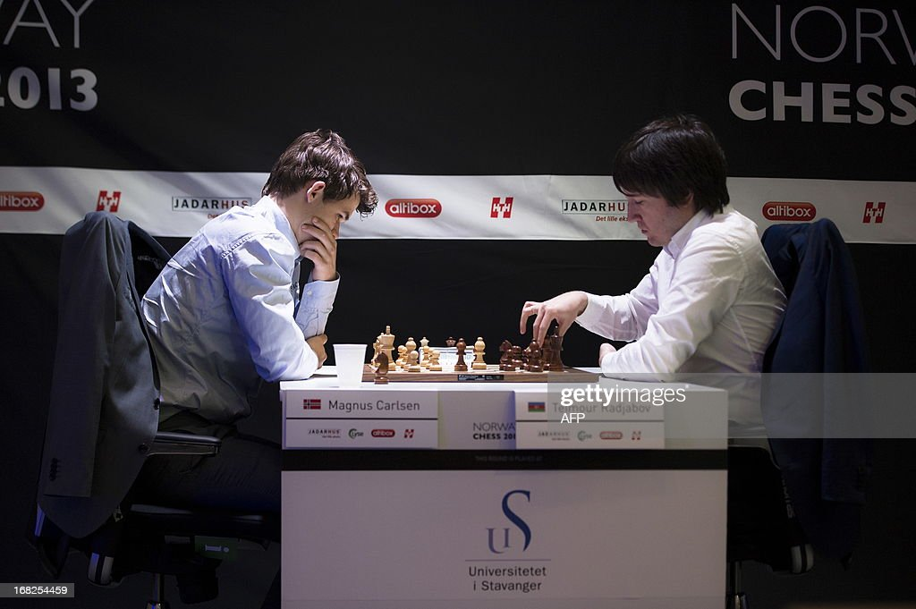 Norway`s Magnus Carlsen (L) plays against Azerbaijan`s Teimour Radjabov during the Norway Chess 2013 Blitz tournament in Sandnes near Stavanger, on May 7, 2013.
