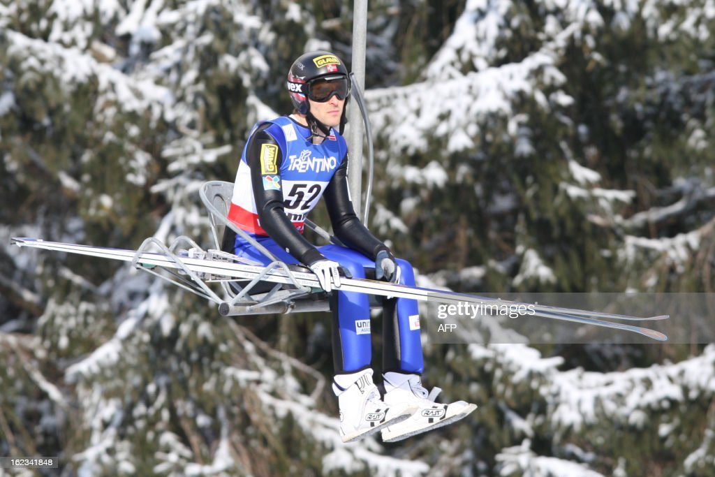 Norway's Magnus H. Moan goes up with the chair lift on February 22, 2013 at the Men's Normal Hill Individual Gundersen of the FIS Nordic World Ski Championships at the Ski Jumping stadium in Predazzo, north Italy. AFP PHOTO / PIERRE TEYSSOT