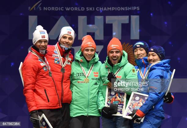 Norway's Magnus Hovdal Moan and Magnus Krog Germany's Eric Frenzel and Johannes Rydzek Japan's Yoshito Watabe and Akito Watabe celebrate during the...