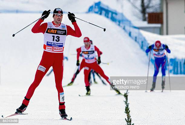 Norway's Magnus Moan celebrates as he crosses the finish line of the10 km Individual Gundersen event in victory to win the Val Di Fiemme Nordic...