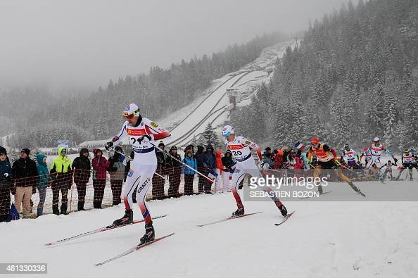Norway's Magnus Moan competes ahead Norway's Magnus Krog and Germany's Fabian Riessle during the individual Gundersen of the FIS Nordic Combined...