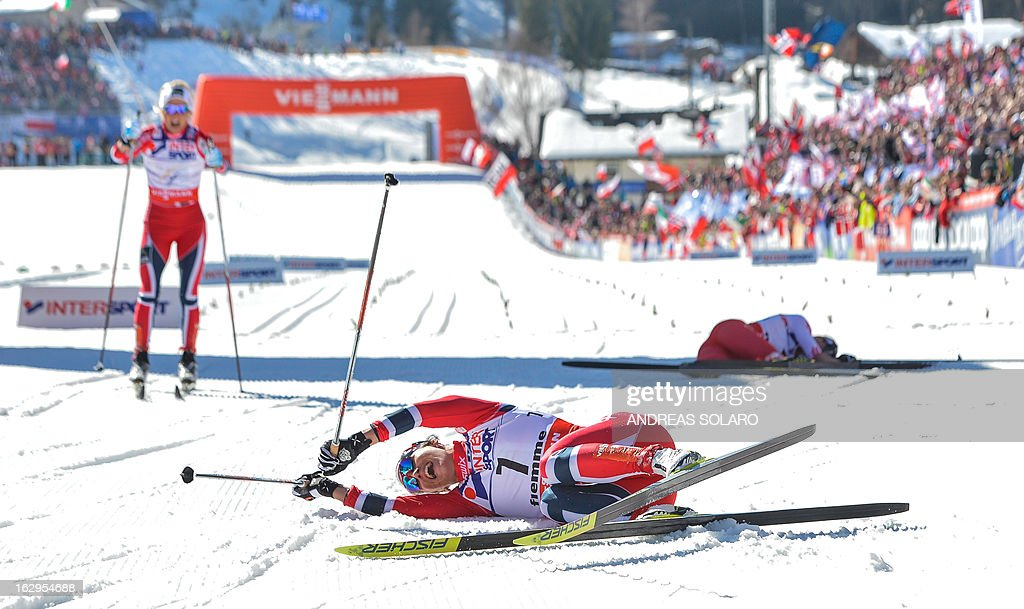 Norway's Marit Bjoergen (C) celebrates her first place on March 2, 2013 in the finish area, next to Norway's Therese Johaug (L) and Poland's Justyna Kowalczyk (R), at the end of the Women's Cross Country 30 km Classic race of the FIS Nordic World Ski Championships at Val Di Fiemme Cross Country stadium in Cavalese, northern Italy.