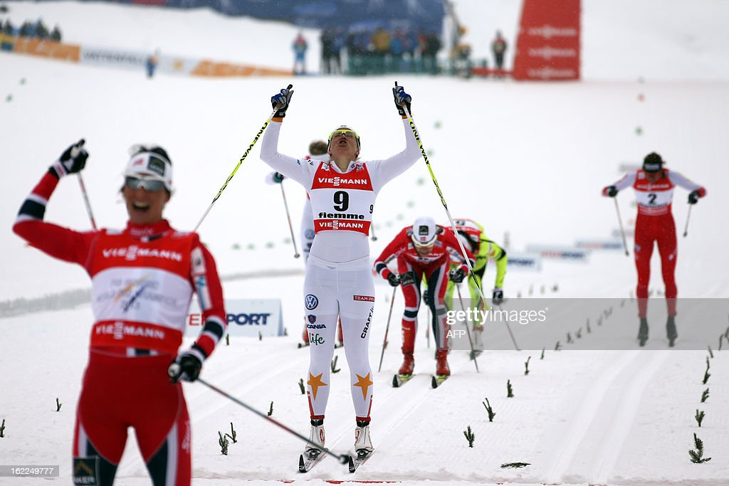 Norway's Marit Bjoergen (L) celebrates on February 21, 2013 as she crosses the finish line ahead of Sweden's Ida Ingemarsdotter (2ndL) and Poland's Justyna Kowalczyk (R) during the Women's Cross Country sprint final 1.2km race of the FIS Nordic World Ski Championships at Val Di Fiemme Cross Country stadium in Cavalese, northern Italy.