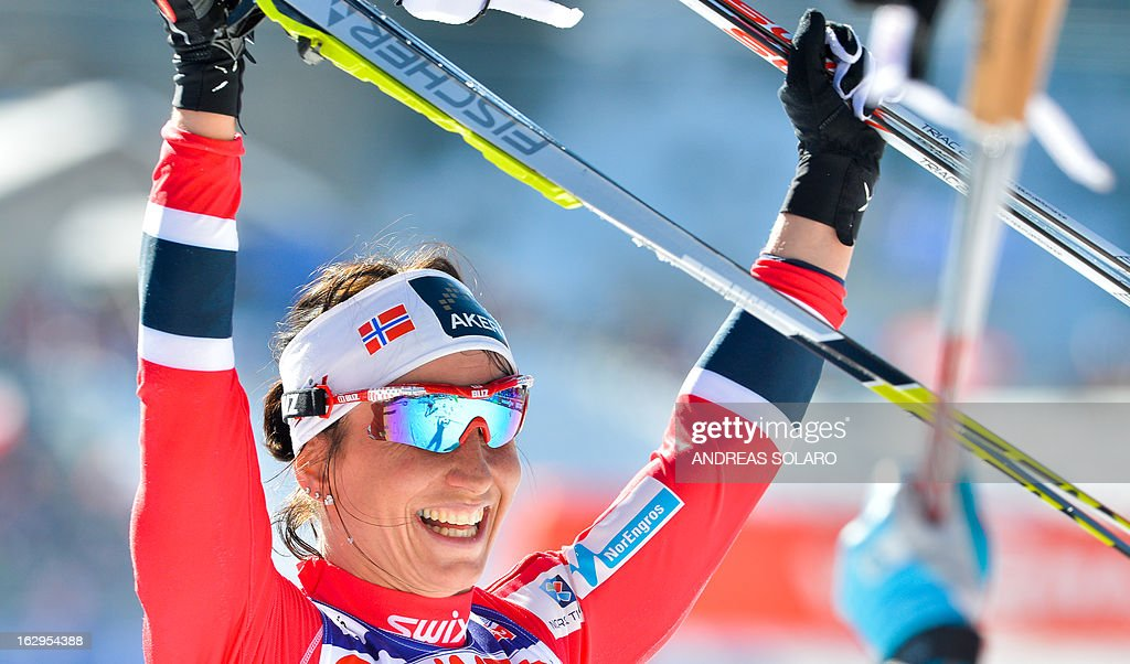 Norway's Marit Bjoergen celebrates on March 2, 2013 in the finish line of the Women's Cross Country 30 km Classic race of the FIS Nordic World Ski Championships at Val Di Fiemme Cross Country stadium in Cavalese, northern Italy. AFP PHOTO / ANDREAS SOLARO