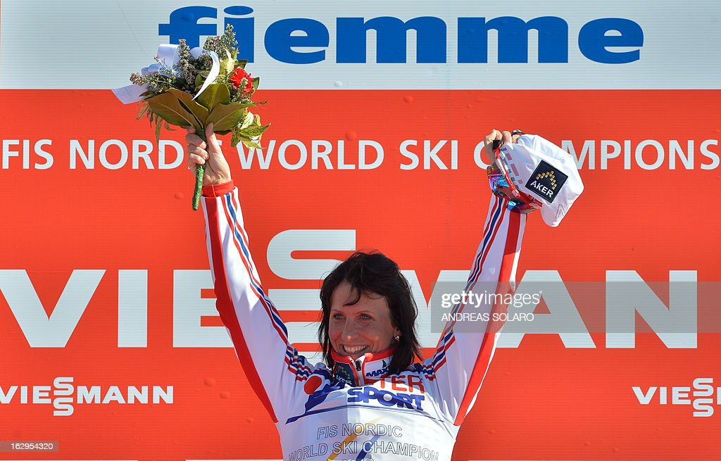 Norway's Marit Bjoergen celebrates winning on March 2, 2013 on the podium in the Women's Cross Country 30 km Classic race of the FIS Nordic World Ski Championships at Val Di Fiemme Cross Country stadium in Cavalese, northern Italy.