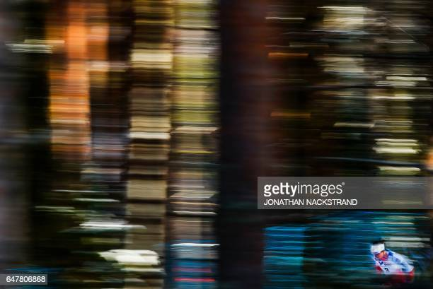 TOPSHOT Norway's Marit Bjoergen competes at the women 30 km Mass Start Free event of the 2017 FIS Nordic World Ski Championships in Lahti Finland on...