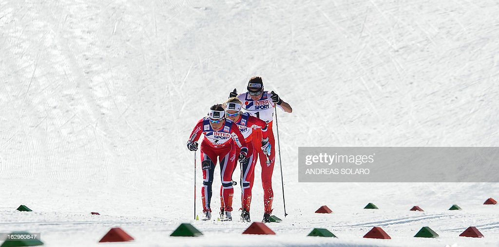 Norway's Marit Bjoergen competes, followed by Norway's Therese Johaug and Poland's Justyna Kowalczyk, on March 2, 2013 during the Women's Cross Country 30 km Classic race of the FIS Nordic World Ski Championships at Val Di Fiemme Cross Country stadium in Cavalese, northern Italy.