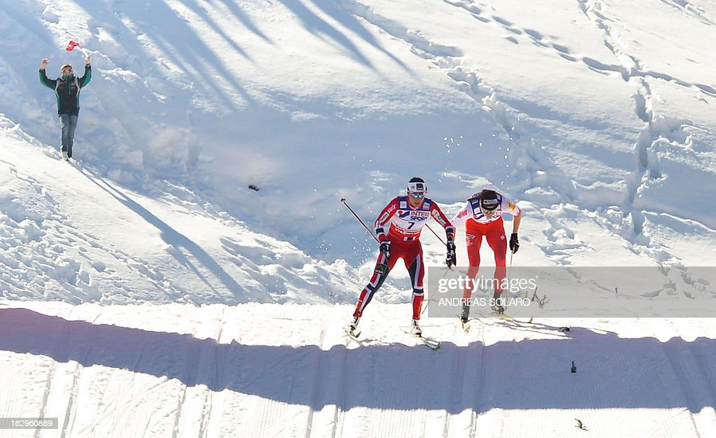 Norway's Marit Bjoergen (L) competes, followed by Poland's Justyna Kowalczyk, on March 2, 2013 during the Women's Cross Country 30 km Classic race of the FIS Nordic World Ski Championships at Val Di Fiemme Cross Country stadium in Cavalese, northern Italy.