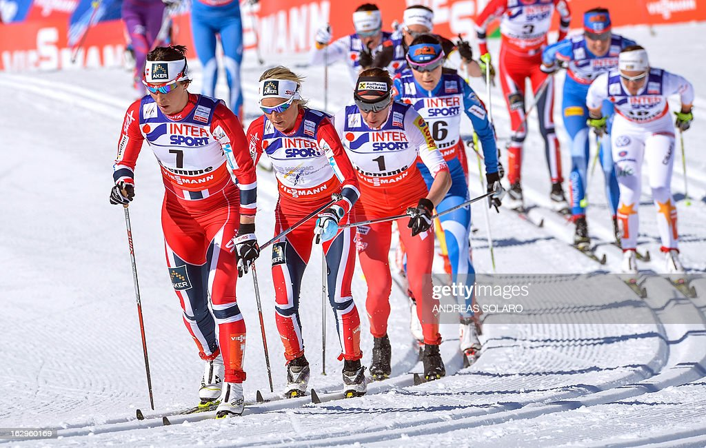 Norway's Marit Bjoergen (L) competes on March 2, 2013 followed by Norway's Therese Johaug and Polish's Justyna Kowalczyk (R) during the Women's Cross Country 30 km Classic race of the FIS Nordic World Ski Championships at Val Di Fiemme Cross Country stadium in Cavalese, northern Italy. AFP PHOTO / ANDREAS SOLARO