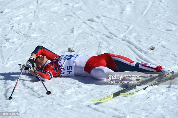 Norway's Marit Bjoergen lies on the snow after competing in the Women's CrossCountry Skiing 10km Classic at the Laura CrossCountry and Biathlon...
