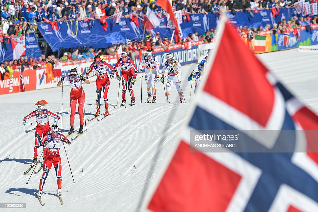 Norway's Marit Bjoergen (2nd L), Norway's Therese Johaug (L) and Poland's Justyna Kowalczyk (3rd L) compete during the Women's Cross Country 30 km Classic race of the FIS Nordic World Ski Championships on March 2, 2013 at Val Di Fiemme Cross Country stadium in Cavalese, northern Italy. AFP PHOTO / ANDREAS SOLARO