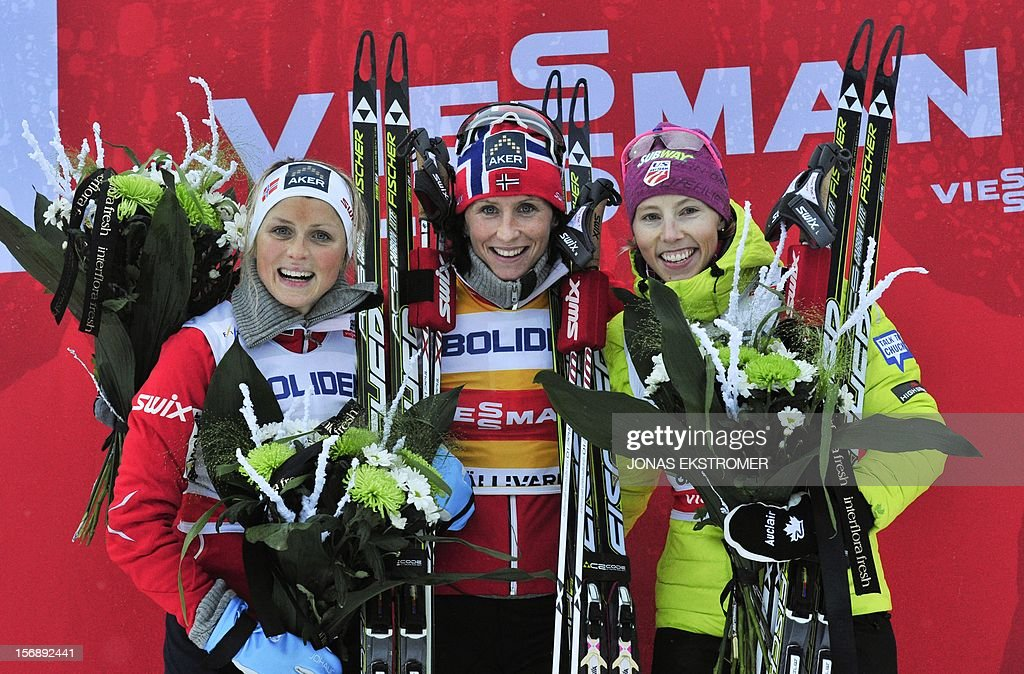Norway's Marit Bjoergen (C), Norway's Therese Johaug (L) and US Kikkan Randall pose for photographers after the ladies 10 km Free Individual distance in the Cross Country world cup tour on November 24, 2012 in Gaellivare, Sweden.Bjoergen won ahead of Johaug and Randall.
