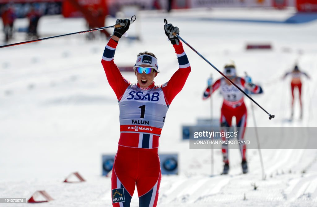 Norway's Marit Bjoergen reacts after crossing the finish line to win the FIS Cross-Country World Cup Ladies 10 km Classic Mass Start in Falun, Sweden, on March 23, 2013. Bjoergen won ahead of Norway's Therese Johaug and Norway's Heidi Weng.