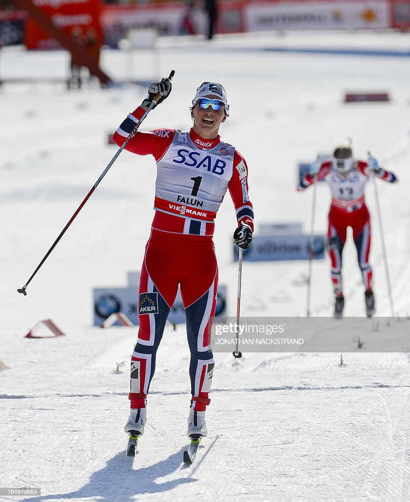 Norway's Marit Bjoergen reacts after crossing the finish line to win the FIS Cross-Country World Cup Ladies 10 km Classic Mass Start in Falun, Sweden, on March 23, 2013. Bjoergen won ahead of Norway's Therese Johaug and Norway's Heidi Weng. AFP PHOTO/JONATHAN NACKSTRAND