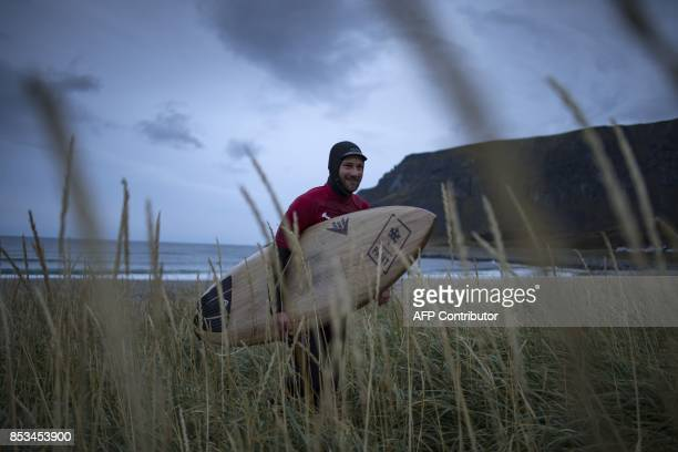 Norway's Markus Wegge walks back to the shore after his early morning session during the Lofoten Masters 2017 the world's most northerly surf...