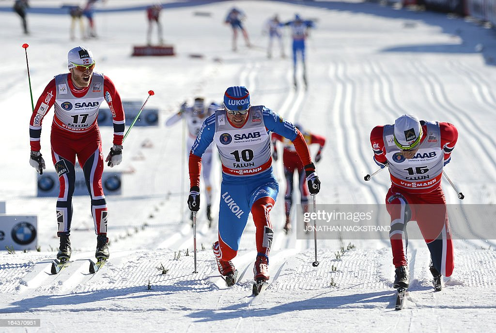 Norway's Martin Johnsrud Sundby (L) looks on as his teammate Eldar Roenning (R) crosses the finish line to win over Russia's Maxim Vylegzhanin during the FIS Cross-Country World Cup Men 15 km Classic Mass Start in Falun, on March 23, 2013.AFP PHOTO/JONATHAN NACKSTRAND