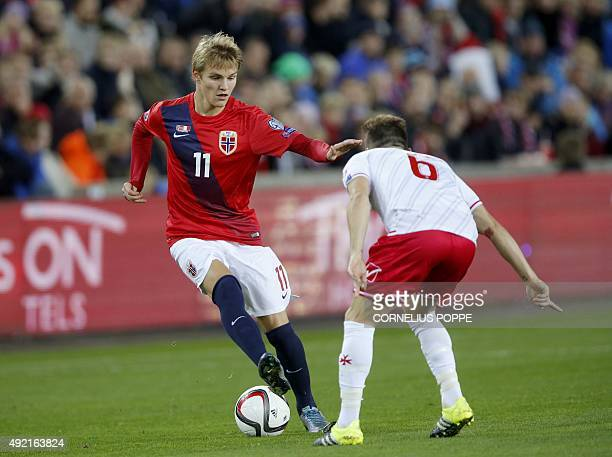 Norway`s Martin Odegaard vies with Malta's Paul Fenech during the Euro 2016 Group A qualifying football match between Norway and Malta in Oslo on...