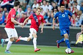 Norway's Martin Oedegaard and Azerbaijan's Dmitri Nazarov vie for the ball during the UEFA Euro 2016 Group H qualifying football match Norway v...