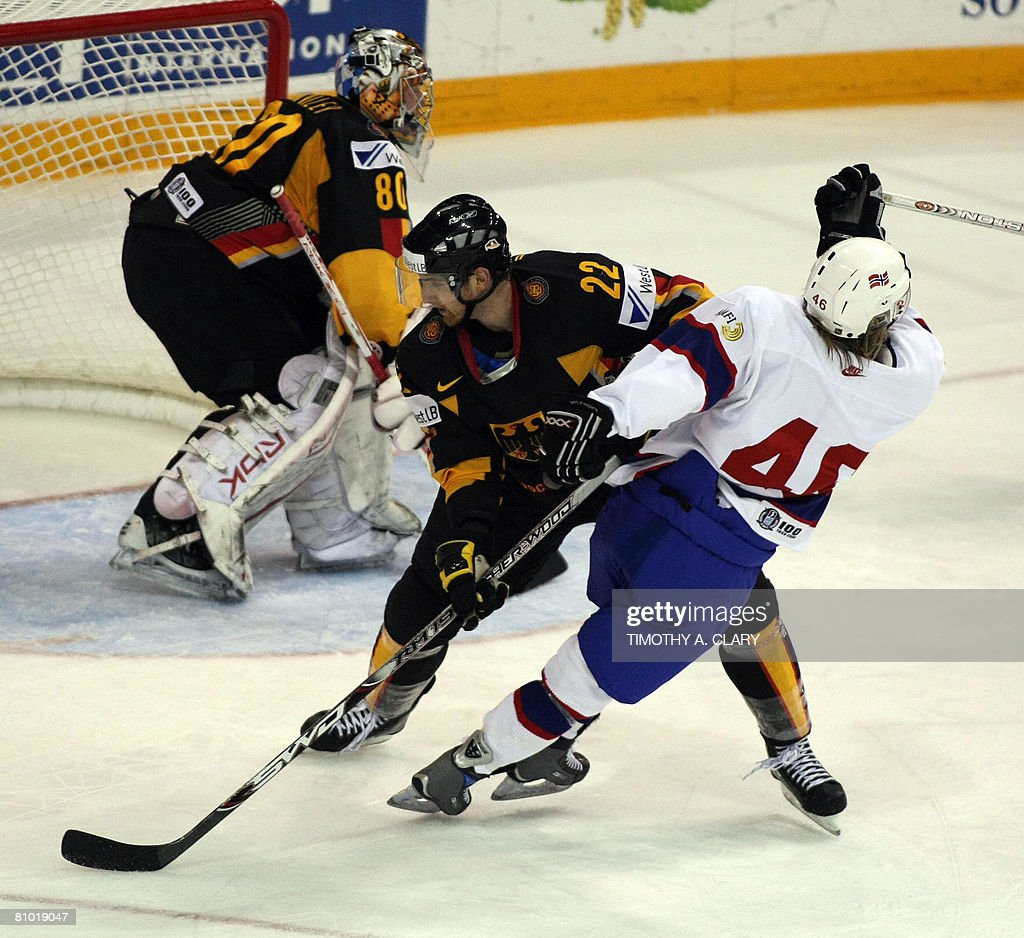 Norway's Mathis Olimb and Germany's Michael Bakos vie for the puck during the preliminary round of the 2008 IIHF World Hockey Championships at the...