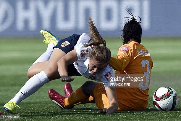 Norway's midfielder Anja Sonstevold is tackled by Ivory Coast's defender Djelika Coulibaly during a Group B match at the 2015 FIFA Women's World Cup...