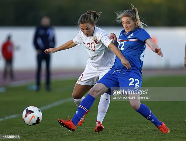 Norway's midfielder Emilie B Haavi vies with Iceland's midfielder Rakel Honnudottir during the Algarve Cup football match Norway vs Iceland at the...