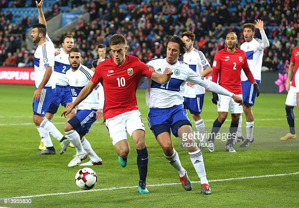 Norway's midfielder Markus Henriksen and San Marino's midfielder Pier Filippo Mazza vie for the ball during the WC 2018 football qualification match...