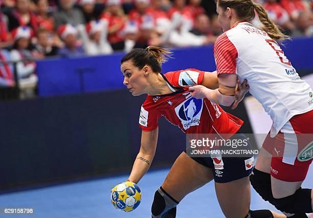 Norway's Nora Mork and Denmark's Anne Mette Hansen vie for the ball during the Women's European Handball Championship Group II match between Denmark...