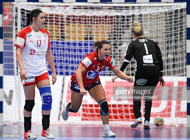 Norway's Nora Mork celebrates after scoring a goal during the Women's European Handball Championship Group II match between Denmark and Norway in...