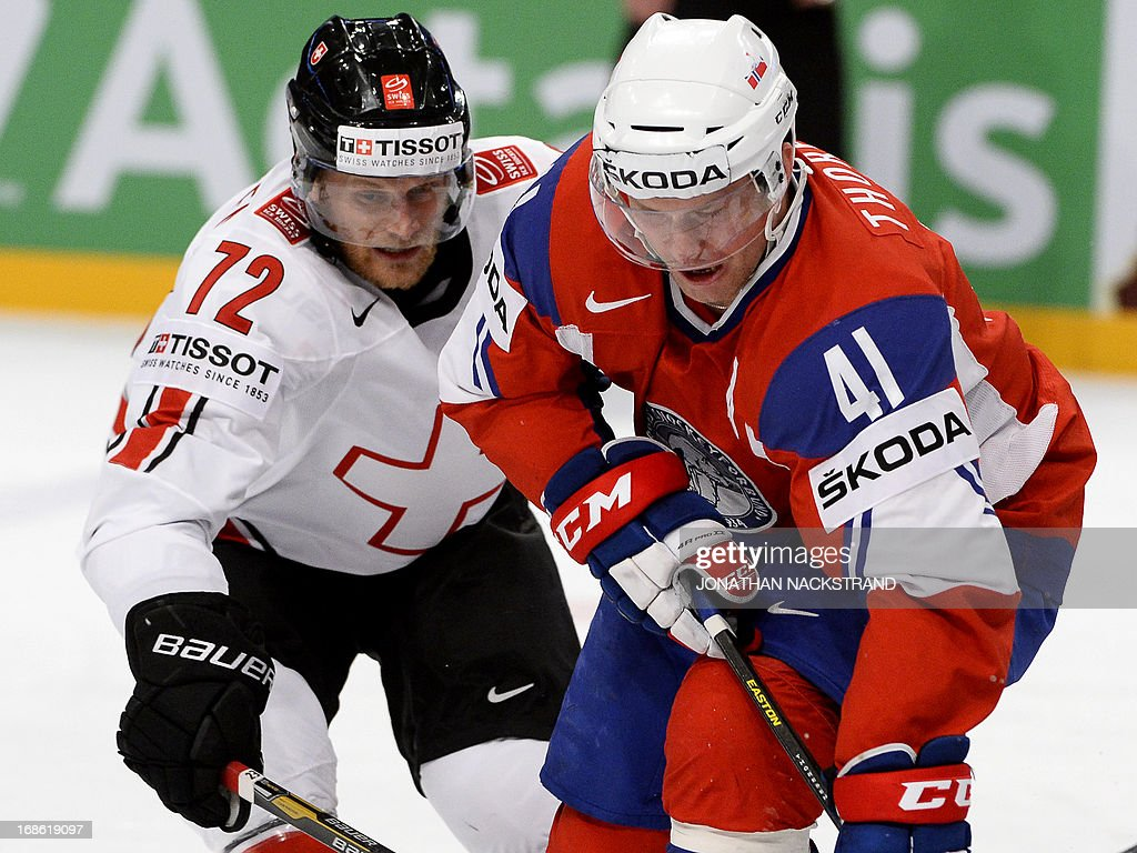 Norway's Patrick Thoresen (R) and Switzerland's Patrick von Gunten vie for the puck during the preliminary round match Norway vs Switzerland at the 2013 IIHF Ice Hockey World Championships on May 12, 2013 in Stockholm.