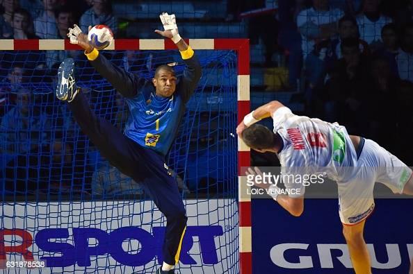 TOPSHOT Norway's pivot Bjarte Myrhol shoots against Brazil's goalkeeper Maik Santos during the 25th IHF Men's World Championship 2017 Group handball...