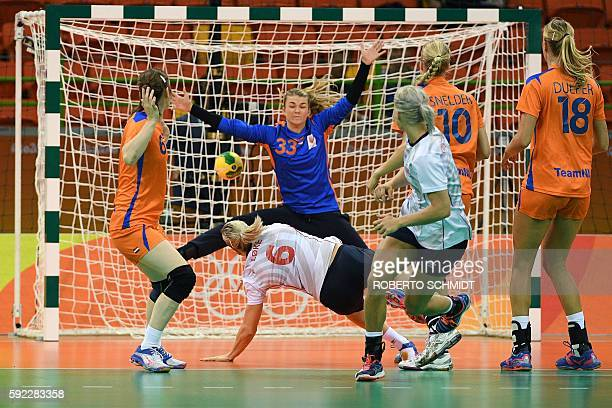 Norway's pivot Heidi Loke shoots at Netherlands' goalkeeper Tess Wester during the women's Bronze Medal handball match Netherlands vs Norway for the...