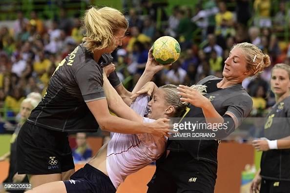 TOPSHOT Norway's pivot Heidi Loke vies with Sweden's left back Linnea Torstensson and Sweden's pivot Linn Blohm during the women's quarterfinal...