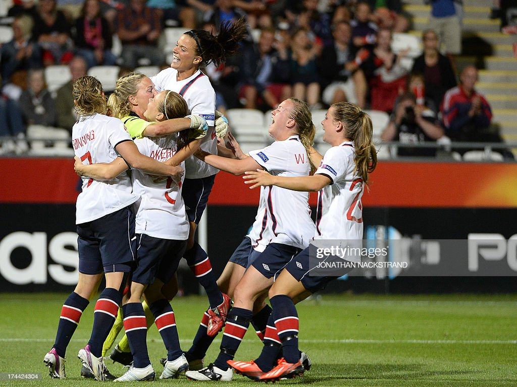 Norway's players celebrate after winning the penalty shootout of the UEFA Women's European Championship Euro 2013 semi final football match Norway vs Denmark on July 25, 2013 in Norrkoping, Sweden. Norway won the match 4-2 after penalties and will face Germany in the final on July 28, 2013.