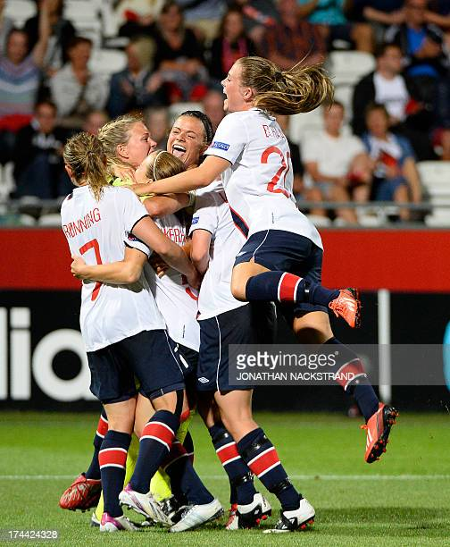 Norway's players celebrate after winning the penalty shootout of the UEFA Women's European Championship Euro 2013 semi final football match Norway vs...